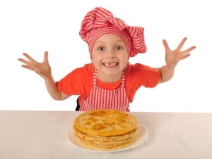 Dutch child with pancakes